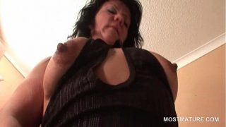 Aroused mature chick masturbating snatch from behind